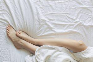 woman in bed exploring self love