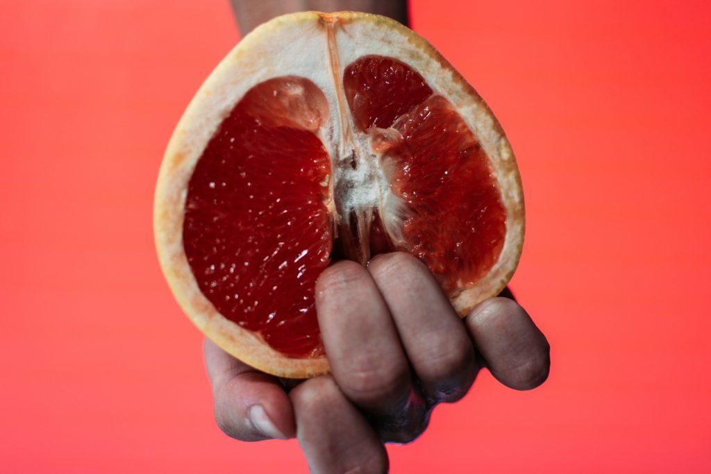 fingers in grapefruit